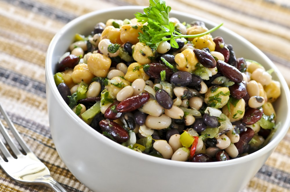 preparing a healthy mexican bean salad